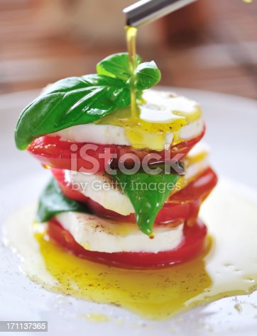 Stack of Tomato and Mozarella with Fresh Basil Leaves. Shallow DOF