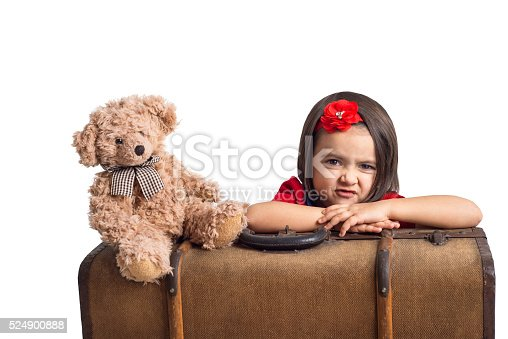 953553492 istock photo Capricious beautiful little Girl with suitcase and toy bear 524900888