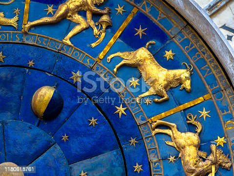 istock Capricorn astrological sign on ancient clock. Detail of Zodiac wheel with Moon and constellations. 1180618761
