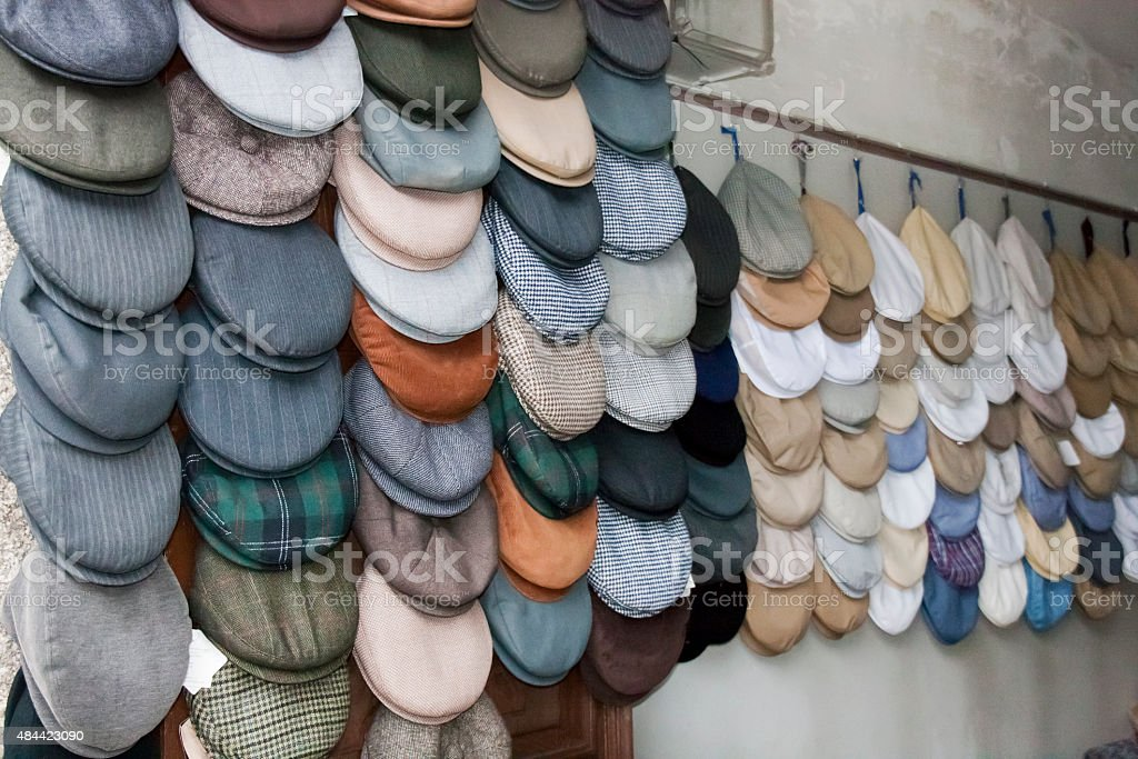 Caps display in a village store. stock photo