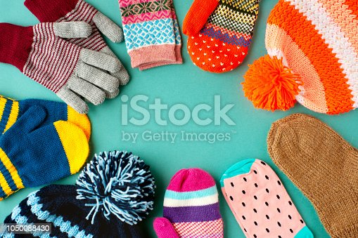 View from above. Warm clothes in the form of hats, mittens, gloves and socks for autumn and winter. Warm clothes for cold seasons.