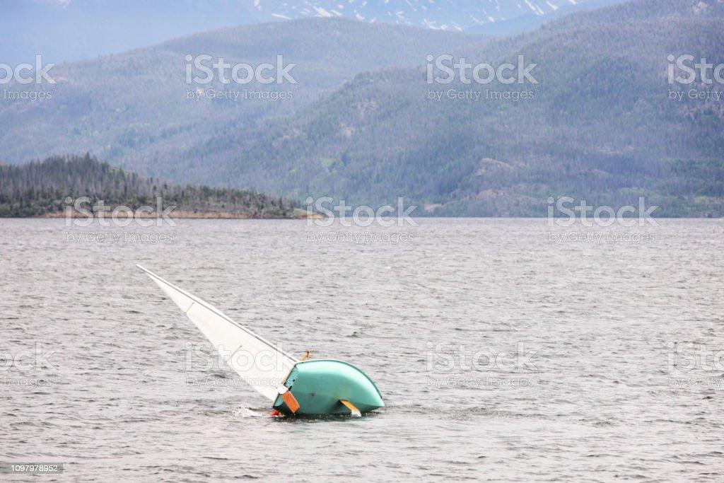 Capsizing Sailboat Wilderness Lake stock photo