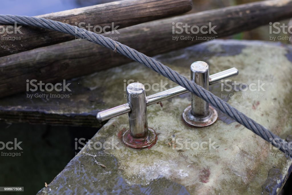 Capstan on a small sailing boat. Equipment for a sailing boat floating in inland waters. Season of the spring. stock photo
