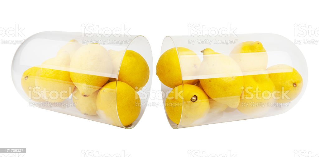 Capsule and lemons royalty-free stock photo