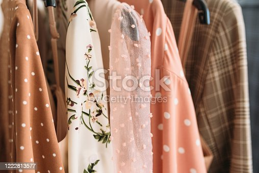 Capsule clothes in beige and pink colors closeup textures.
