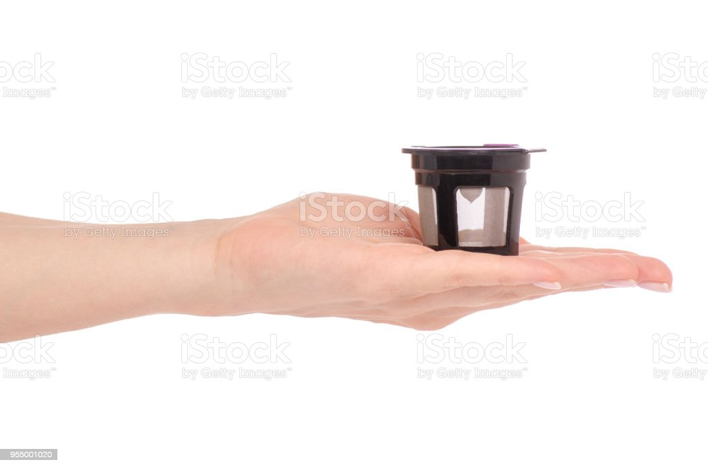 Capsule for coffee machine in hand stock photo