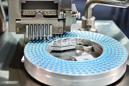 1087546614istockphoto Capsule medicine pill production line, Industrial 1156053221