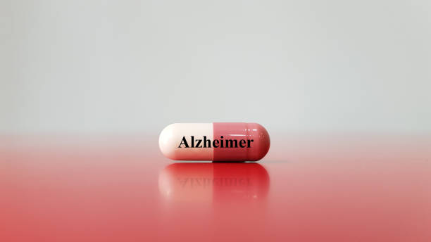 Capsule of medicine for treatment Alzheimer's disease. Alzheimer cause brain cells degeneration that lead to memory loss (dementia disorder). skills. Neurology and medical technology concept. stock photo