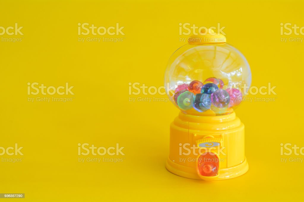 Capsule toy abstract minimal yellow background stock photo