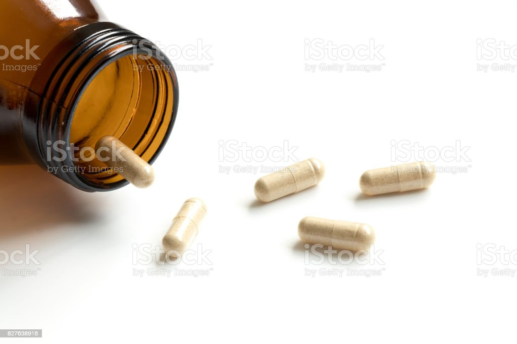 Capsule with amber bottle on white background and have the copy space for add text stock photo