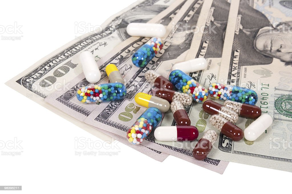 capsules and US dollars royalty-free stock photo