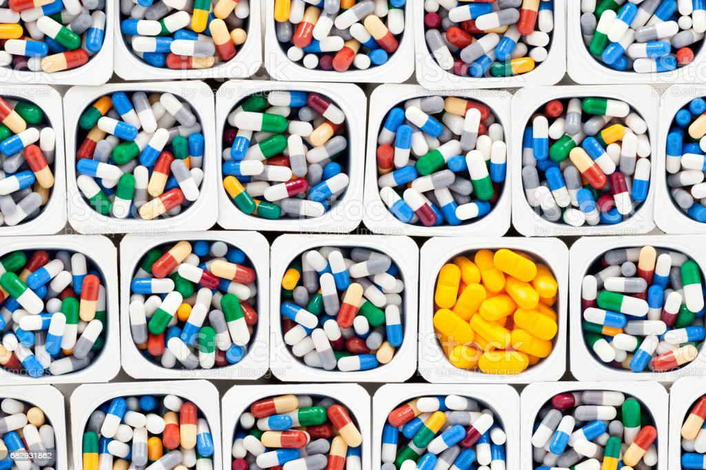 Capsules and yellow pills royalty-free stock photo