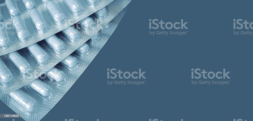 Capsules, blue hue royalty-free stock photo