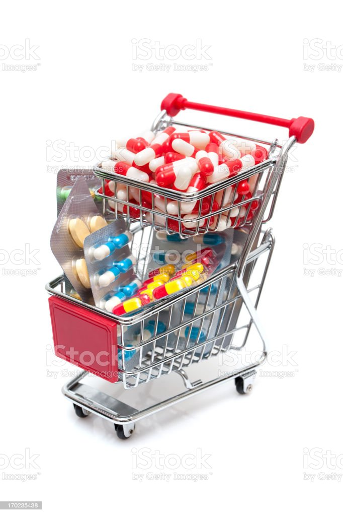 Capsules in the Shopping Cart isolated on white background royalty-free stock photo