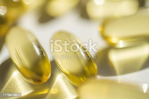 Close up capsules of fish fat oil , omega 3, vitamin Healthy food diet. Nutritional supplement