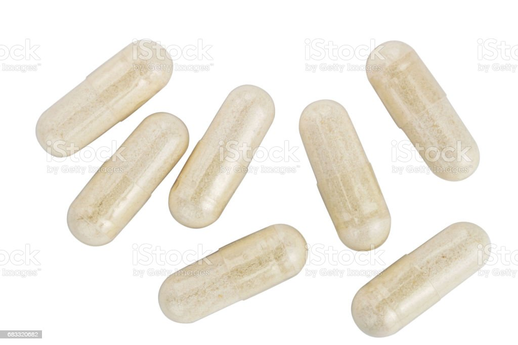 Capsules of glucosamine chondroitin, healthy supplement pills isolated on white background, top view royaltyfri bildbanksbilder