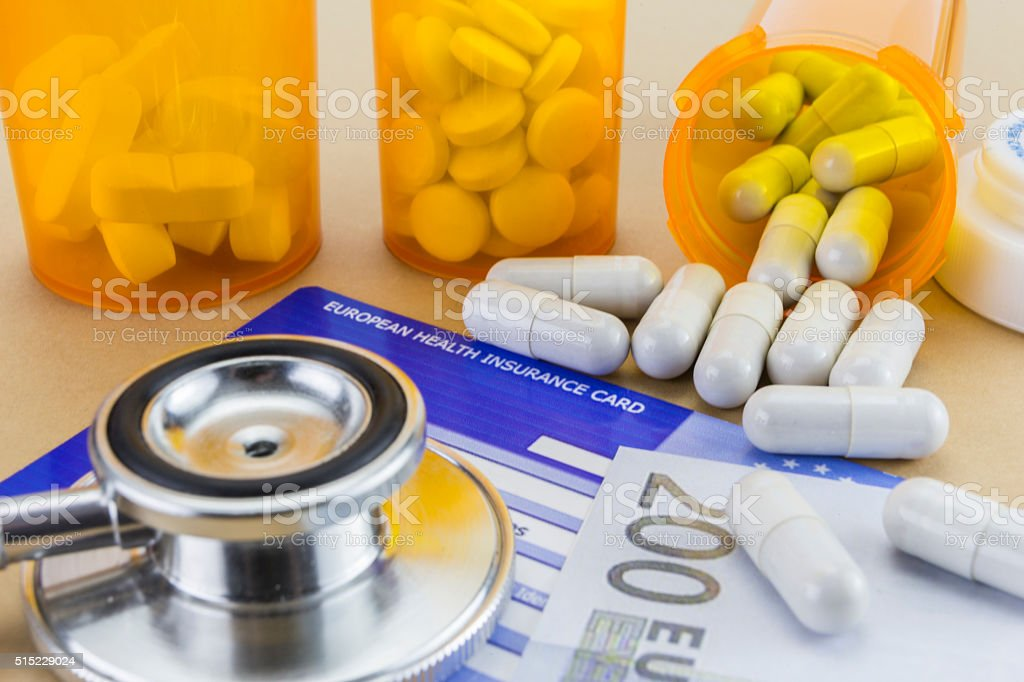 capsules up ticket euro and european health insurance card, conc stock photo