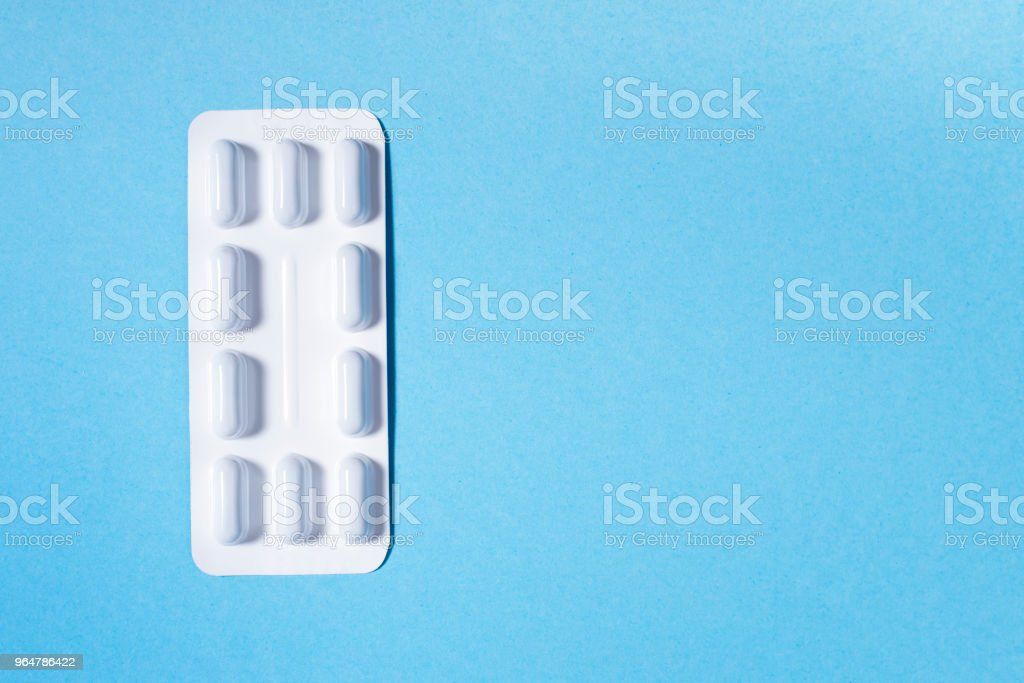 Capsules with drugs in  white package royalty-free stock photo