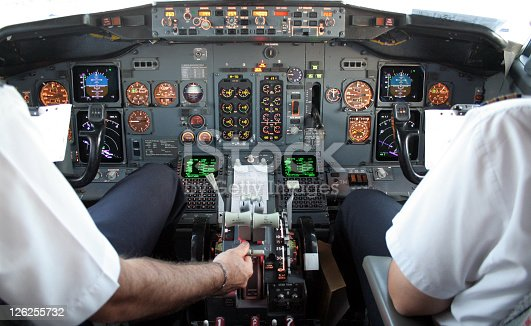Aircraft Cockpit Boeing 737 prior to take off. Captain and first officer run through a pre flight check. Note the