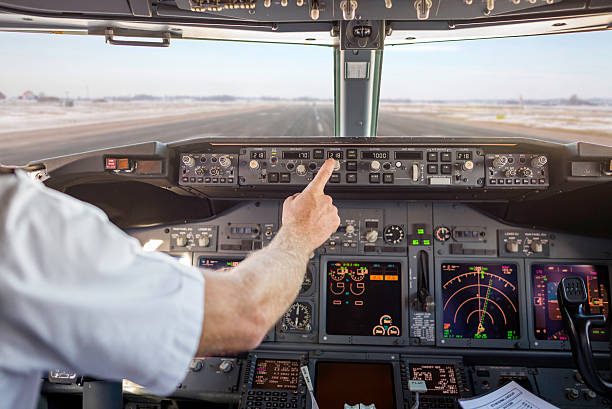 Captain checking heading, before takeoff stock photo