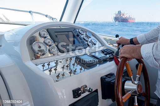 istock Captain control hand throttle on speedboat 1268252404