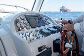 istock Captain control hand throttle on speedboat 1268252404