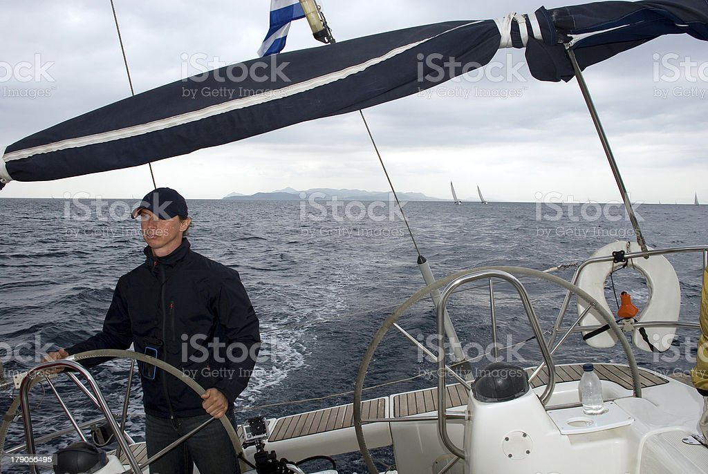 Captain controls the yacht. royalty-free stock photo