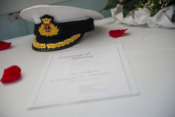Captain hat and documents Captain hat and documents sailor hat stock pictures, royalty-free photos & images