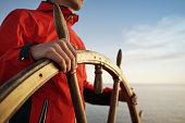 Man Holding Hands on ship rudder