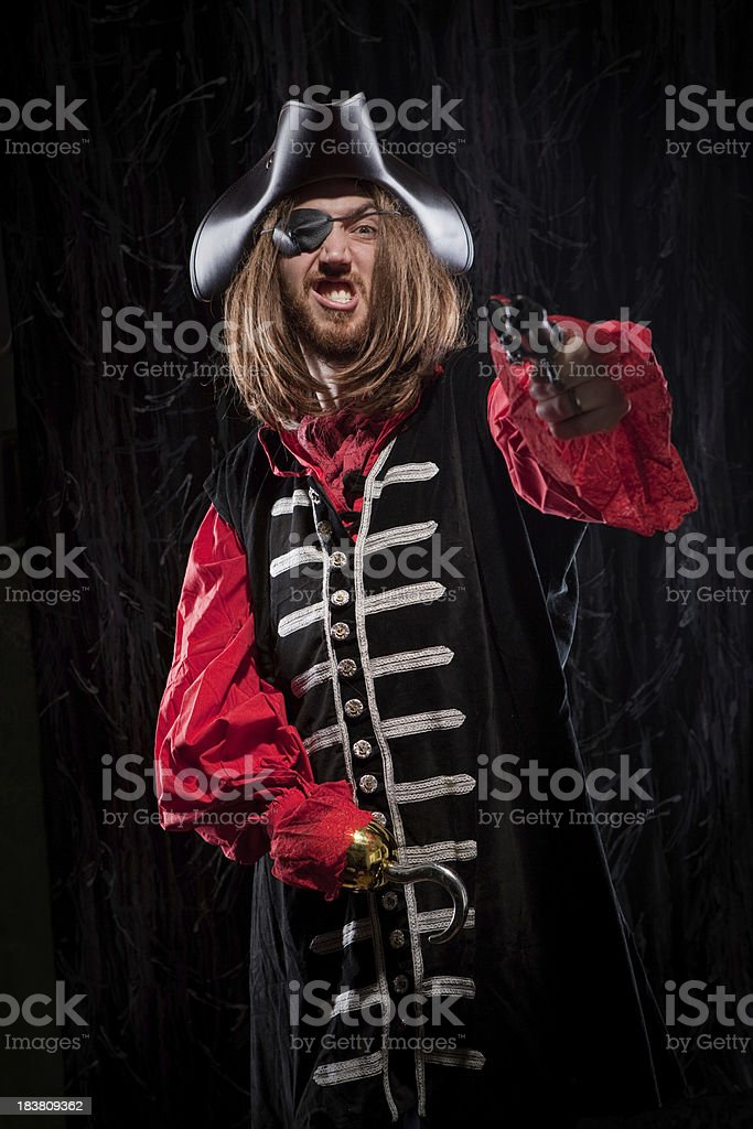 Captain Hook Buccaneer Man holding flintlock pistol historical garb stock photo