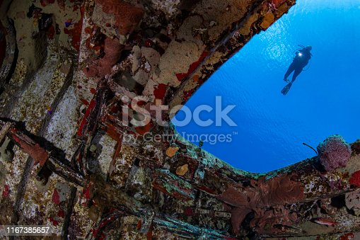 View of the MV Captain Keith Tibbetts shipwreck and female diver in Cayman Brac - Cayman Islands