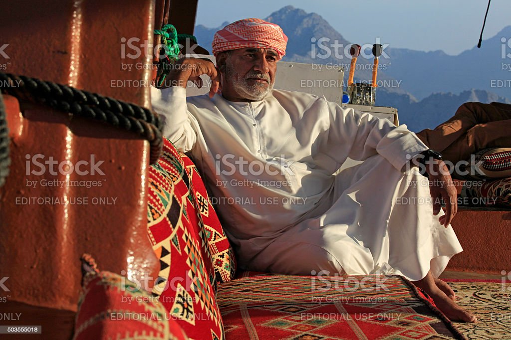 Captain of a Dhow resting, Musandam coast, Oman stock photo