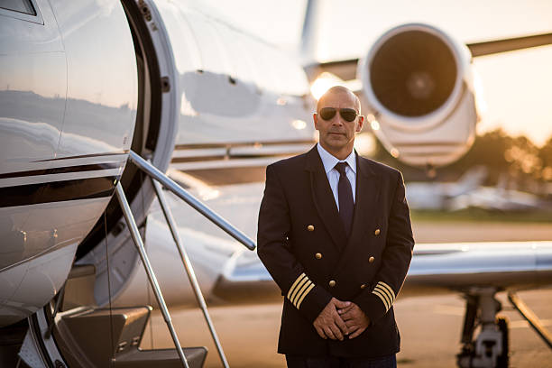 Captain of private jet airplane stock photo