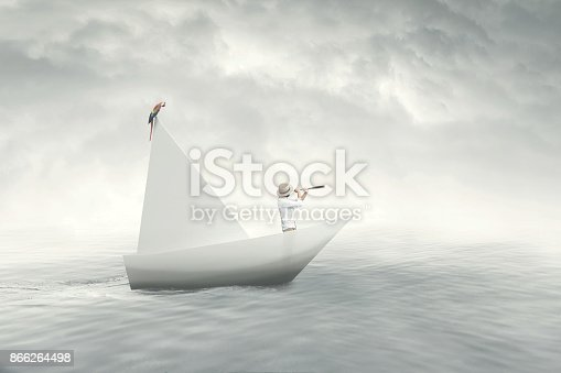 istock captain on a paper boat 866264498