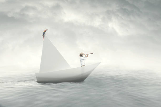 captain on a paper boat stock photo