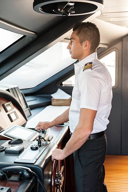 captain operating yacht - steuerungstechnik stock-fotos und bilder