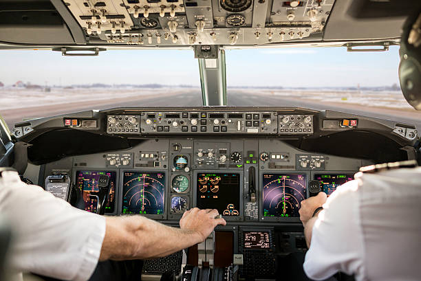 captain pulling an aircraft throttle - cockpit stock photos and pictures