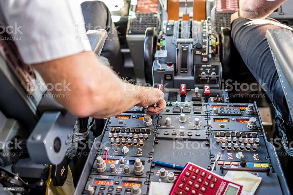 Captain setting up VHF panel stock photo