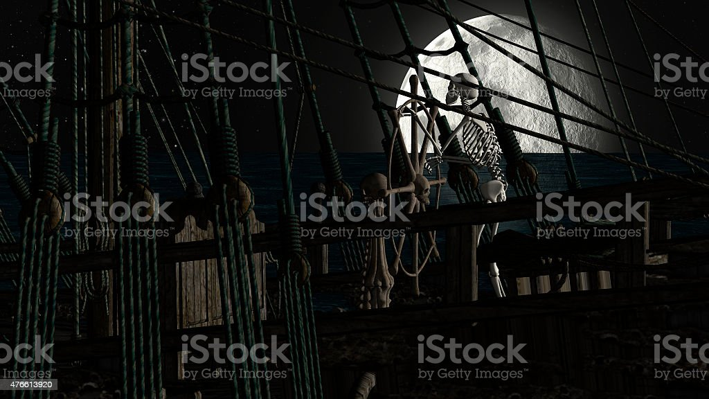 Captain skeleton in a ghost boat by night time stock photo