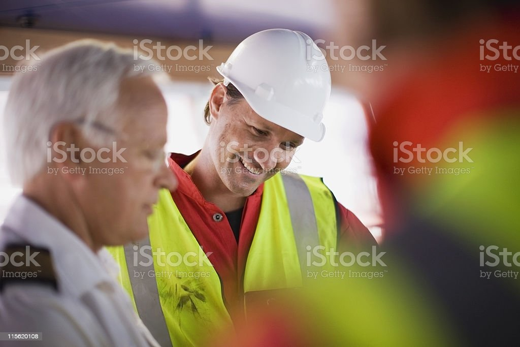 Captain talking to workers stock photo