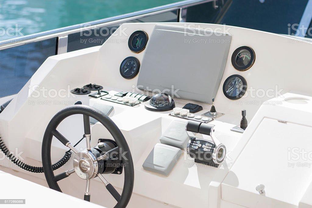 Captain wheel on the luxury yacht stock photo