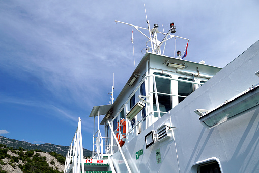 Prizna, Croatia, 18th Jun, 2021. Captains cabin at the top of the big white ferry boat, view from below