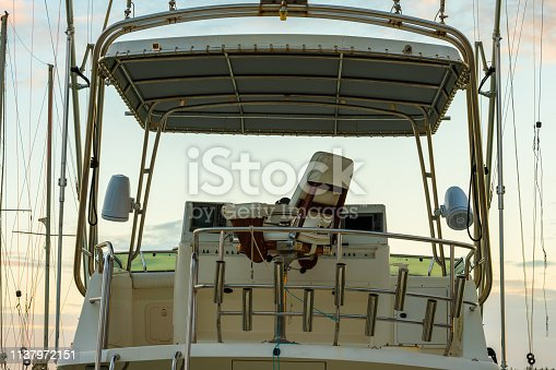 Captains Chair at the helm of on an old white yacht/boat behind the wheel and controls