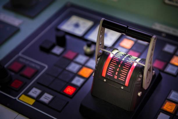 captain's hand on ship throttle. - principe harry foto e immagini stock