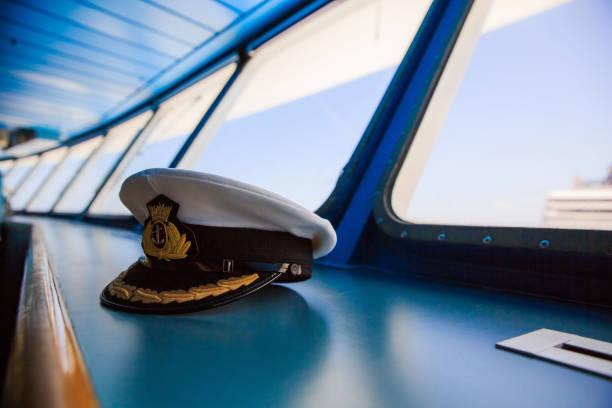 Captain's hat on the ship bridge Captain's hat on the ship bridge sailor hat stock pictures, royalty-free photos & images