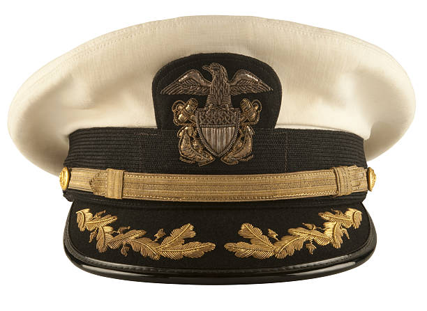 Captain's Hat Vintage 1960's Navy Captain's Hat on white. sailor hat stock pictures, royalty-free photos & images