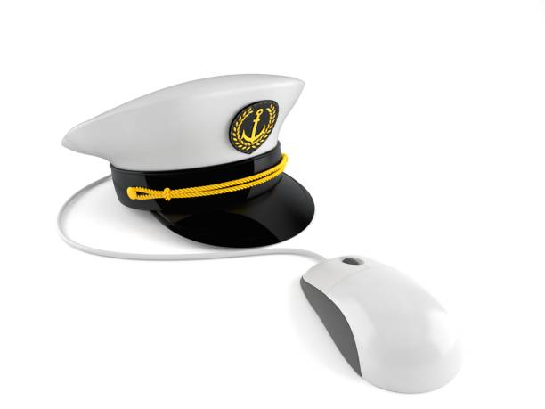 Captain's hat with computer mouse Captain's hat with computer mouse isolated on white background sailor hat stock pictures, royalty-free photos & images