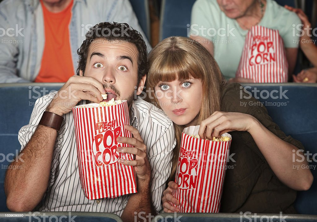 Captivated Couple in Theater stock photo