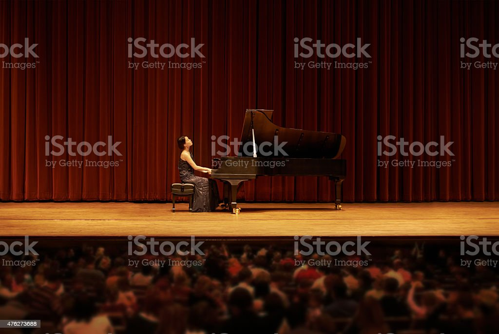Captivating the crowd with her beautiful sounds stock photo