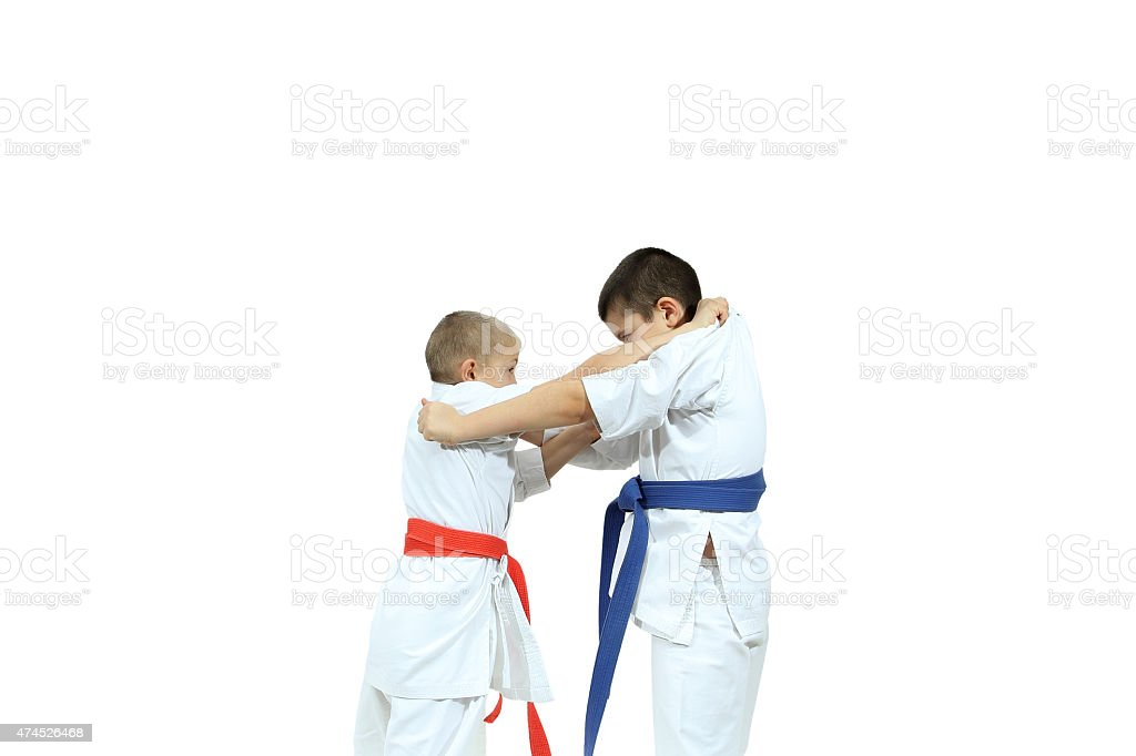 Capture of the judogi are doing two athletes stock photo